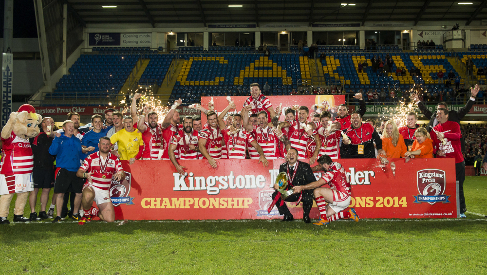 Picture by Allan McKenzie/SWpix.com - 05/10/2014 - Rugby League - Kingstone Press Championship Grand Final - Leigh Centurions v Featherstone Rovers - Headingley Carnegie Stadium, Leeds, England - Leigh Centurions celebrate winning the Kingstone Press Championship Trophy.